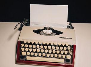 white and black typewriter on white tabl