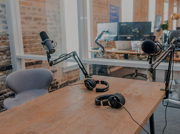 Podcast studio with microphones and headphones on table