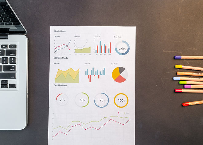 charts-on-black-wooden-table-669622.jpg