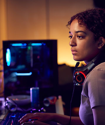 female-teenage-hacker-sitting-in-front-o