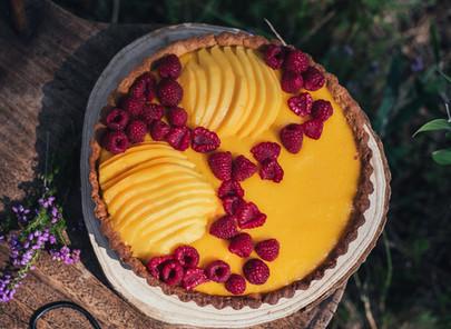 mango curd tart with raspberries