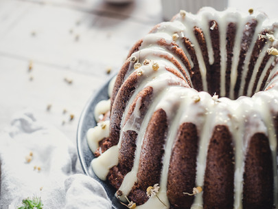 chamomile honey olive oil cake with white chocolate glaze