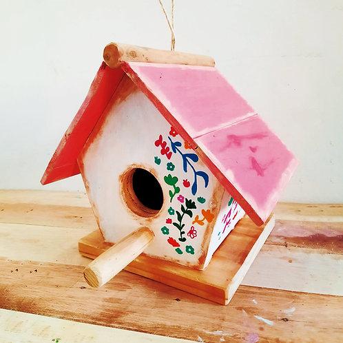 Casa pajaritos rosada