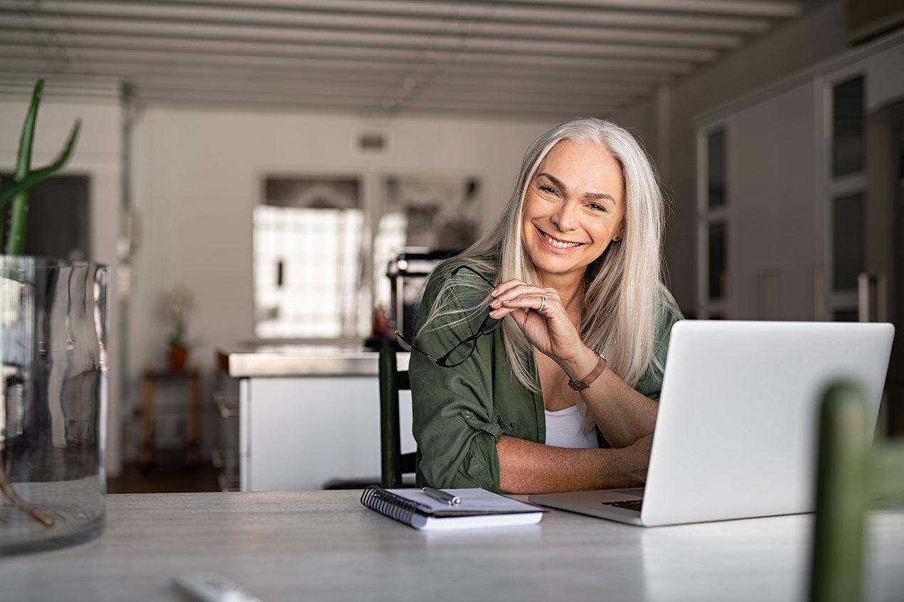 Portrait of happy senior woman holding e