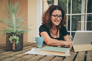 Middle aged female studying at home with