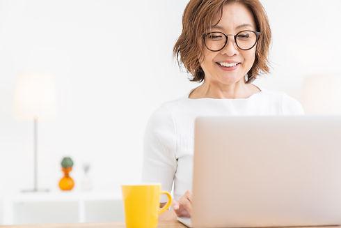Asian senior age woman using laptop.jpg