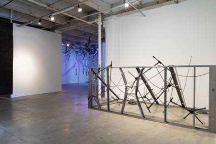 INTERCEPTOR, 2019 Mic stands, cables, metal studs.  Dimensions variable
