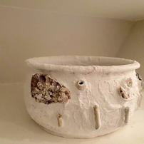 River Pot. Found pot with found objects from the hhames at low Ttde, set with plaster of paris