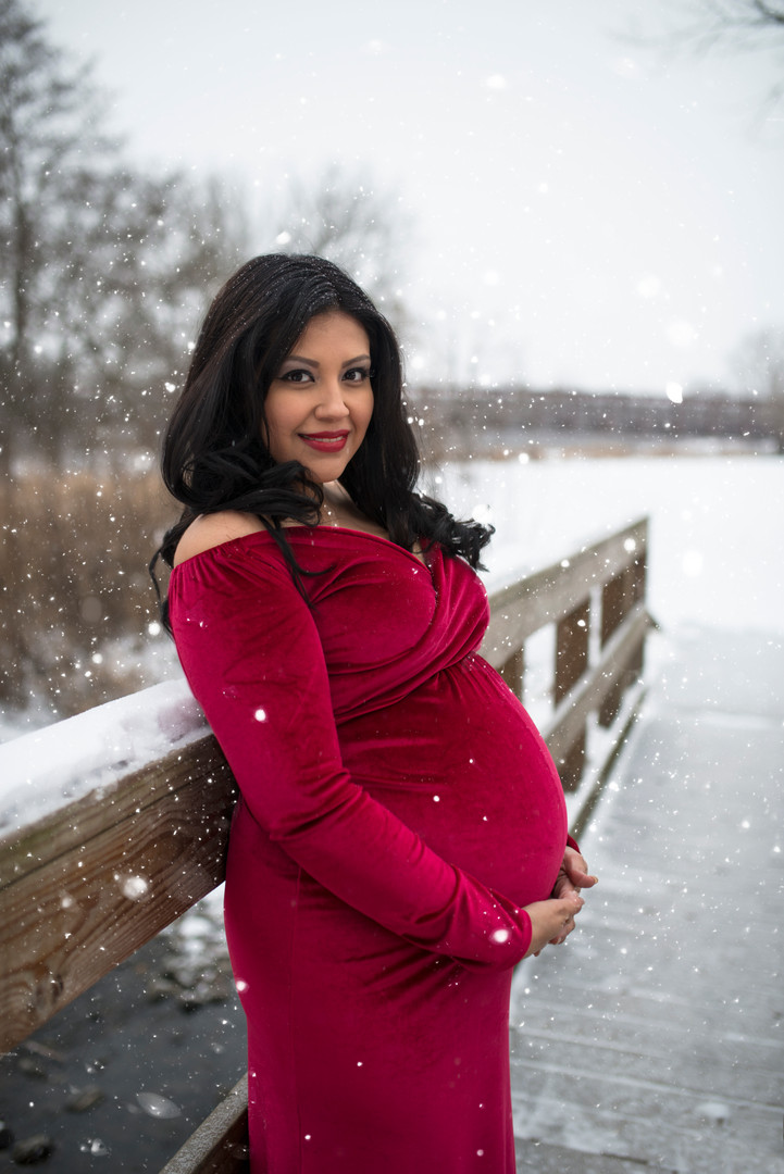 red gown snow maternity photo session
