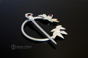 Garnet frost penannular brooch. Sterling