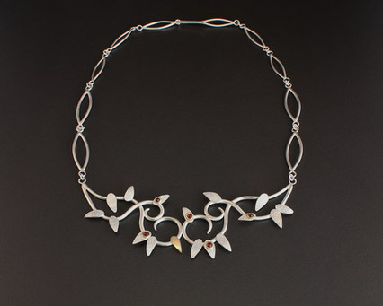 Neckpiece. Sterling silver with gold and garnet