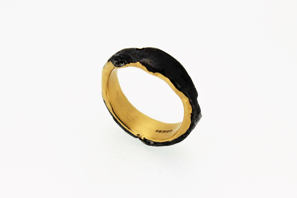 Ring. steel and solid 22ct gold