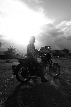 riding Royal Enfield motorcycle in Nepal
