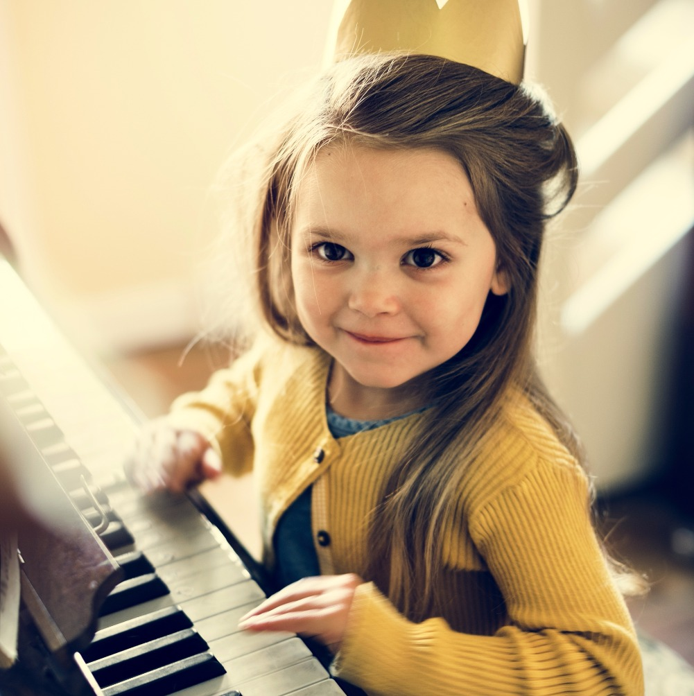 Adorable Cute Girl Playing Piano Concept_edited