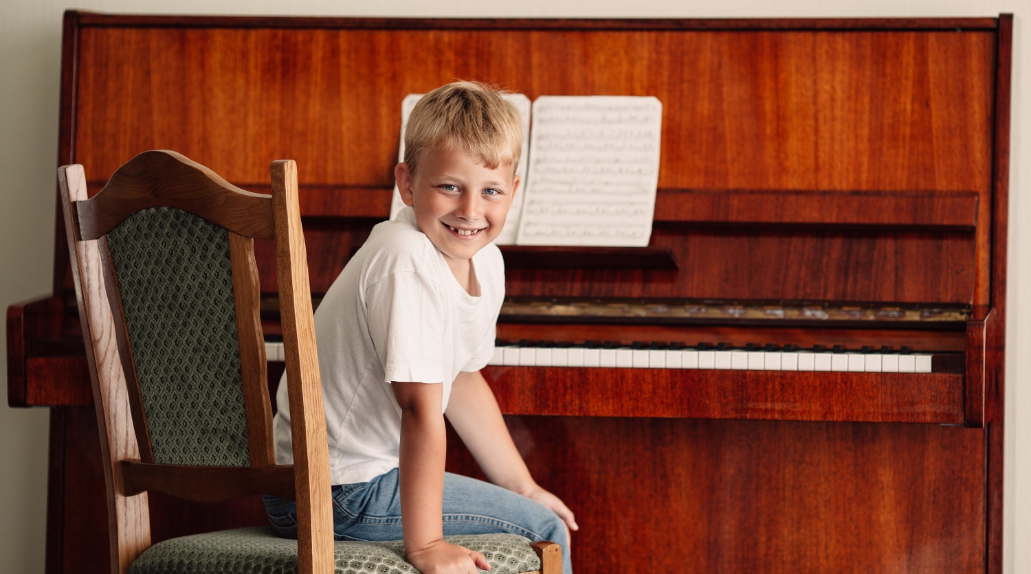 little boy plays piano at home_edited