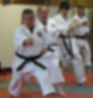 Black and brown belts running Anaku