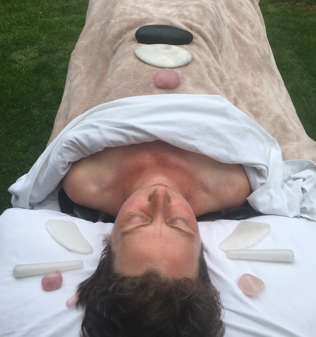 Stone style facial, involves face sculpt massage with rose quartz and white jade.