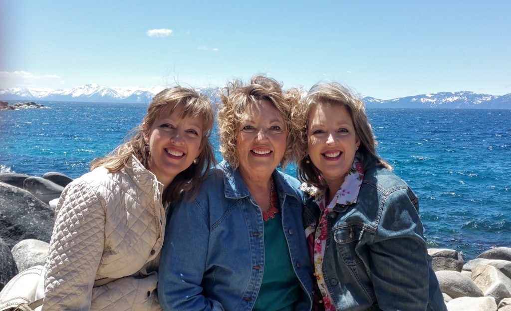 Twin sisters Lora and Lisa with their mother, Carolyn