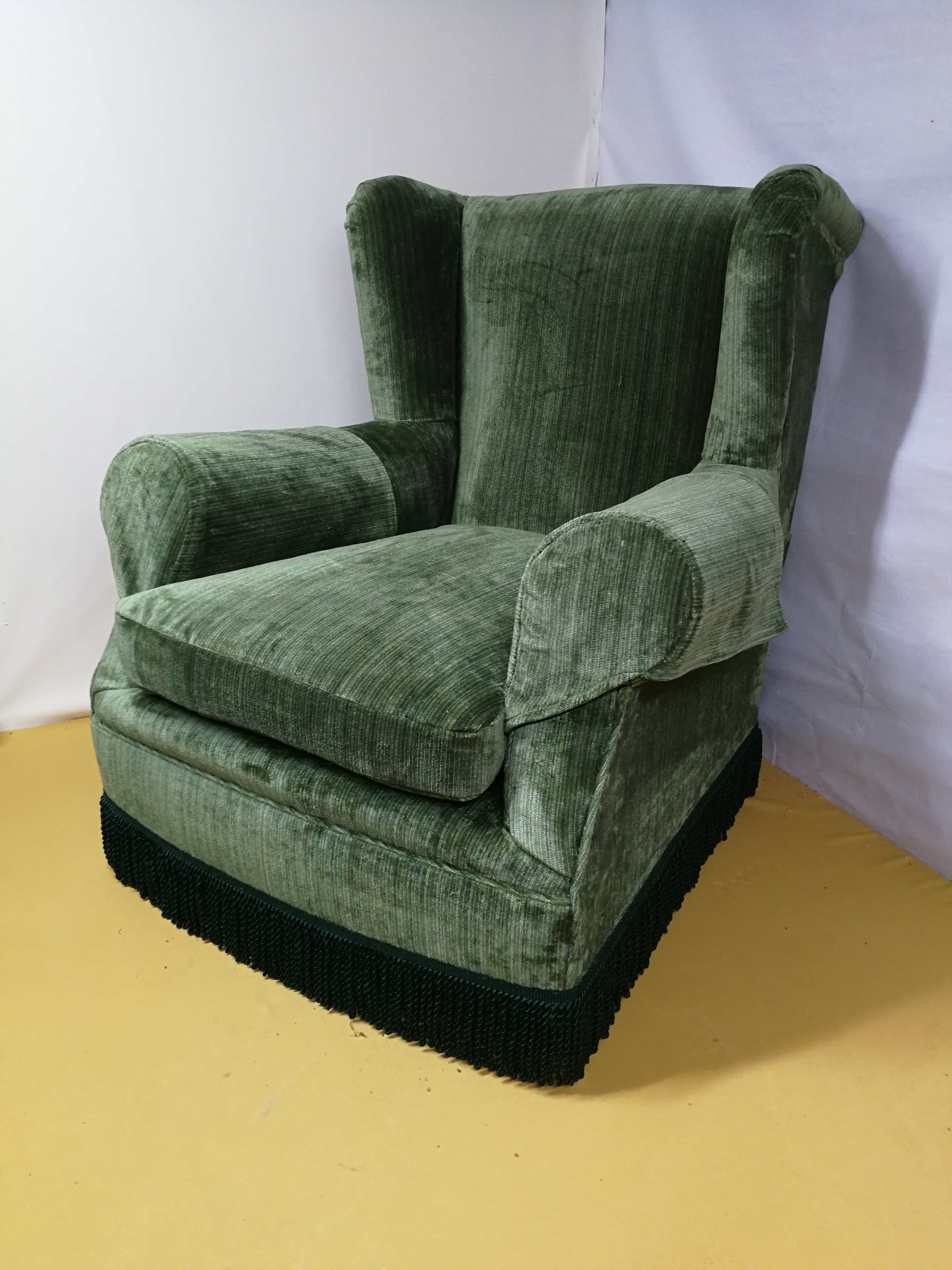 Green velvet arm chair