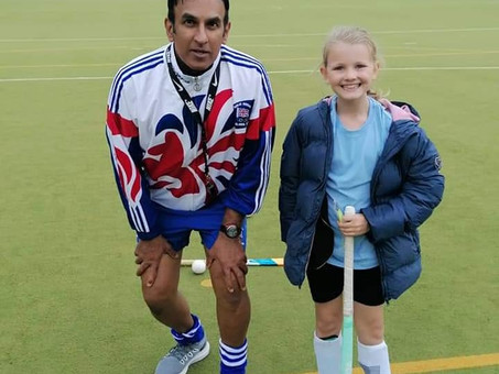 Samantha on the hockey pitch with a GB player!