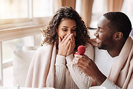 Amazed African American couple getting e
