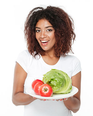 happy-young-african-woman-holding-vegeta