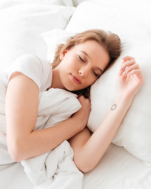 sleeping-young-woman-lies-bed-with-eyes-