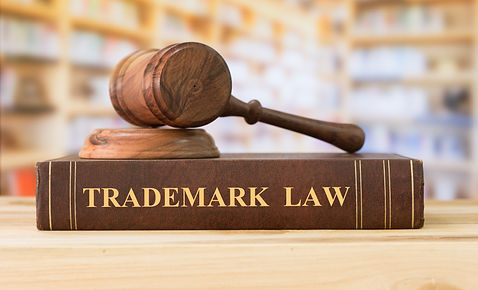 Trademark law books and a judge gavel on