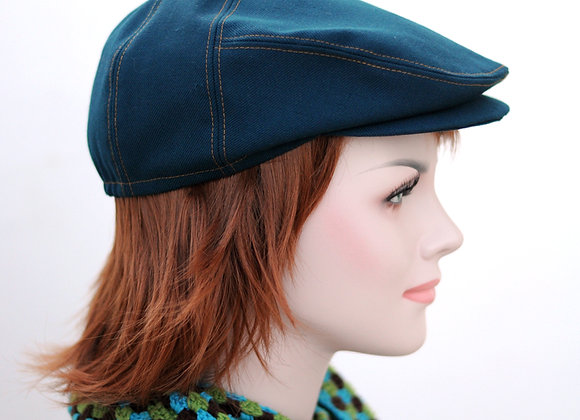 Teal hat with contrasting orange seams and beautiful paisley lining