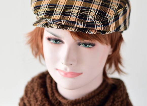 Tartan flat cap in brown, peach, and black