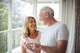 happy-senior-couple-interacting-with-eac
