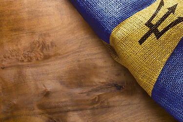 State Barbados flag on a wooden backgrou