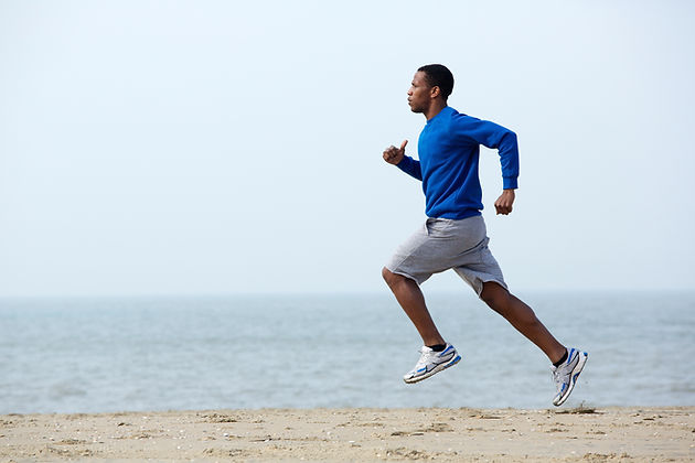 Male running along the beach
