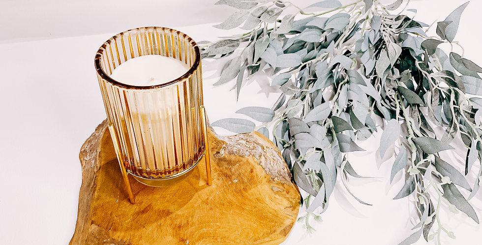 "Bougies ""Calypso"", bougeoir en verre orangé, socle doré..."