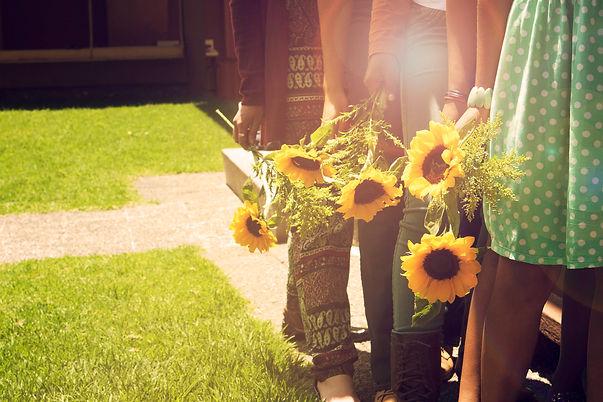 Casa Adalia Sunflowers with girls at Cas