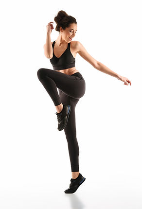 happy-fitness-woman-moving-looking-away_