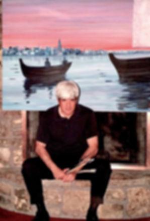 """Artist Stephen Shoel Wachtel in front of his painting in progress, """"In the Harbor."""""""
