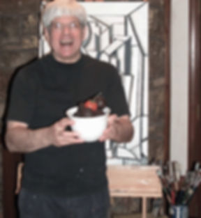 Artist Stephen Shoel Wachtel laughing with props in front of a cubist painting in progress.