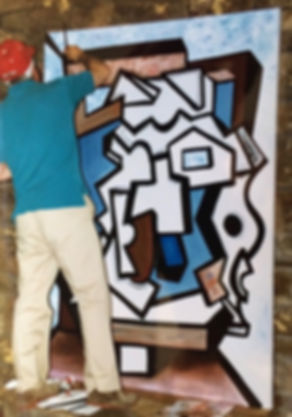 """Artist Stephen Shoel Wachtel adds brushstrokes to his large cubist painting, """"Resolution of Paradox."""""""