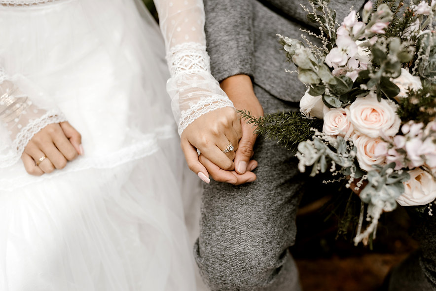 Canva - Bride And Groom Holding Hands.jp