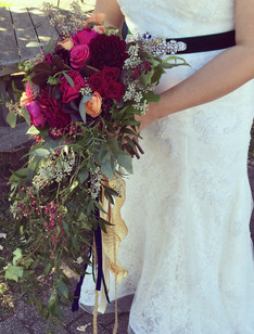 cascading burgundy and pink bridal bouquet with trailing greens