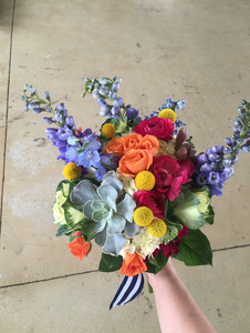 bright multicolor bridal bouquet with blue, green, hot pink, orange and yellow