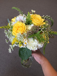 garden style bridal bouquet with white hydrangea and yellow roses