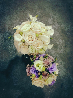formal traditional bouquet of roses and calla lilies in blush and lavender