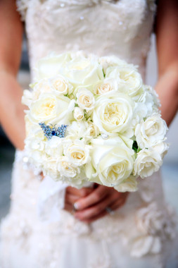 traditional white rose and hydrangea bouquet with vintage brooches