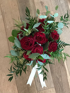 red rose bridal bouquet with varied greenery
