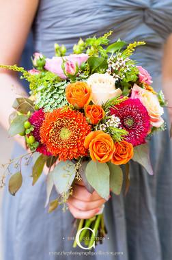 cheery orange and pink bridesmaid's garden style bouquet
