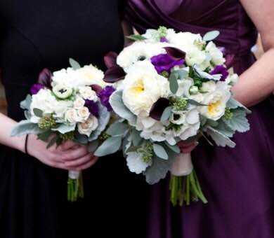 traditional white and purple bouquet with garden roses and calla lilies
