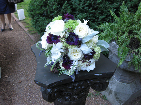 garden style white, green and purple bridal bouquet with herbs