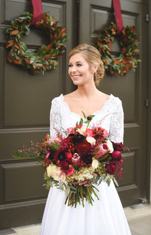 red, burgundy and mauve winter bridal bouquet